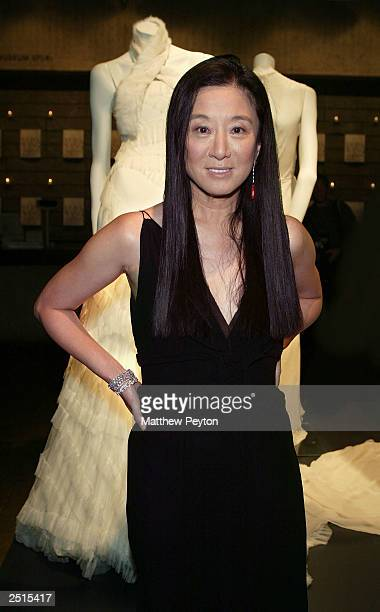 Vera Wang poses with the Vera Wang bridal exhibit at the Whitney Museum of American Art as part of the Wedding March On Madison September 20, 2003 in...