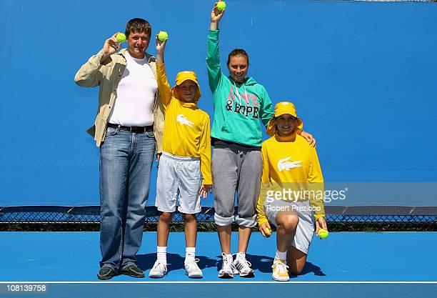 Vera Zvonareva of Russia and former tennis player Yevgeny Kafelnikov poses with Australian Open ball kids during day three of the 2011 Australian...