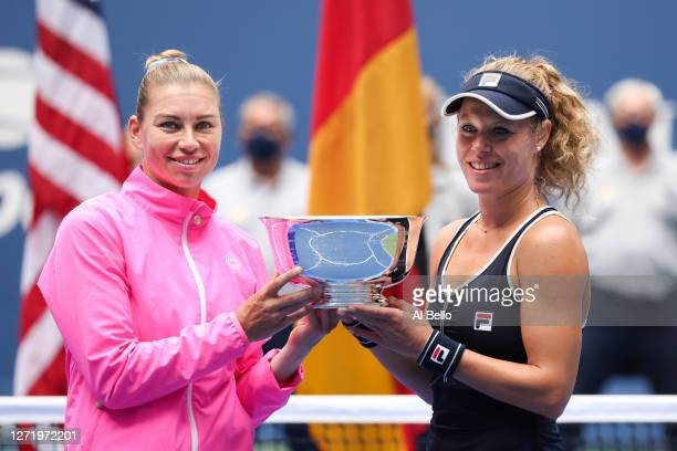 Vera Zvonareva of Russia and Laura Siegemund of Germany celebrate winning their Women's Doubles final match against Nicole Melichar of the United...