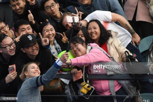 Vera Zvonareva of Russia celebrates by taking a selfie with fans after winning against Ivana Jorovic of Serbia during the women's singles 2nd Round...
