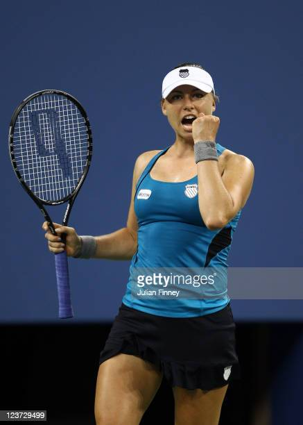 Vera Zvonareva of Russia celebrates defeating Sabine lasicki of Germany during Day Seven of the 2011 US Open at the USTA Billie Jean King National...