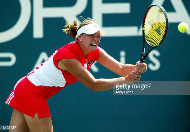 Vera Zvonareva of Russia hits a return during her match against Venus Williams on April 16 2004 during the Family Circle Cup at the Family Circle...