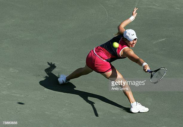 Vera Zvonareva of Russia hits a return in her 6175 win over Michaella Krajicek of the Netherlands during the Family Circle Cup at the Family Circle...