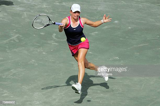 Vera Zvonareva of Russia hits a return in her match against Dinara Safina of Russia during the Family Circle Cup at the Family Circle Tennis Center...