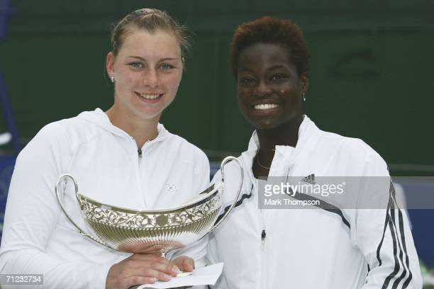 Vera Zvonareva of Russia holds the Maud Watson trophy as she poses with losing finalist Jamea Jackson of the USA after the final of the DFS Classic...