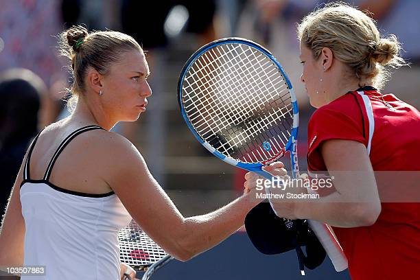 Vera Zvonareva of Russia is congratulated at the net by Kim Clijsters of Belgium after their match during the Rogers Cup at Stade Uniprix on August...