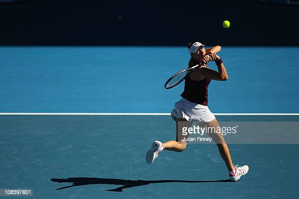 Vera Zvonareva of Russia plays a backhand in her semifinal match against Kim Clijsters of Belgium during day eleven of the 2011 Australian Open at...