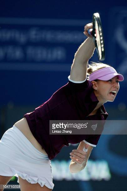 Vera Zvonareva of Russia plays a forehand during her match against Dinara Safina of Russia during day four of the 2010 China Open at the National...
