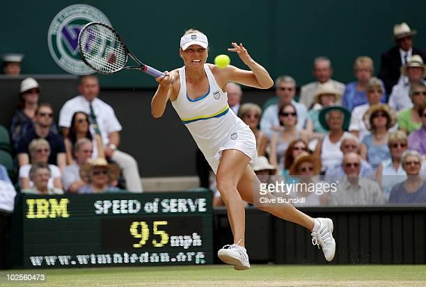 Vera Zvonareva of Russia plays a shot during the Ladies Semi Final match against Tsvetana Pironkova of Bulgaria on Day Ten of the Wimbledon Lawn...