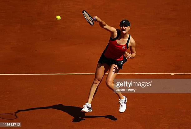Vera Zvonareva of Russia plays a smash in her match against Petra Kvitova of Czech Republic during day five of the Mutua Madrilena Madrid Open Tennis...