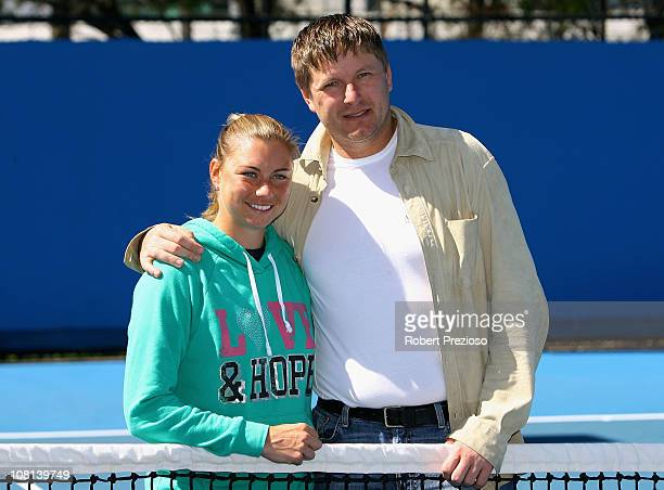 Vera Zvonareva of Russia poses with former tennis player Yevgeny Kafelnikov during day three of the 2011 Australian Open at Melbourne Park on January...