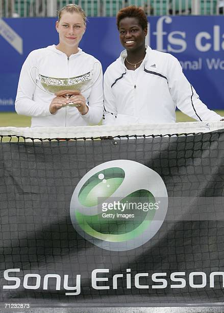 Vera Zvonareva of Russia poses with the Maud Watson trophy and Jamea Jackson of the USA after her victory in the final of the DFS Classic at...