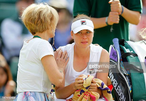 Vera Zvonareva of Russia receives medical attention during her Ladies' singles third round match against Kim Clijsters of Belgium on day five of the...