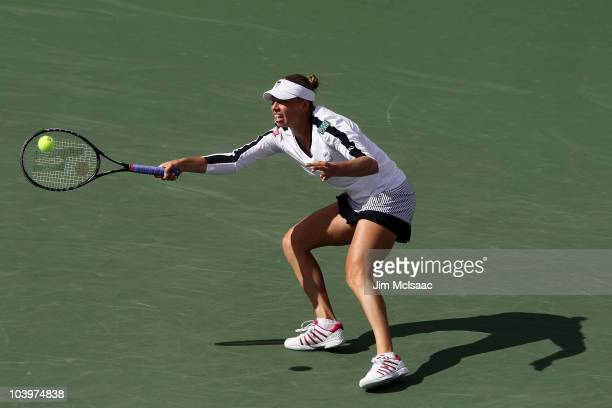 Vera Zvonareva of Russia returns a shot against Caroline Wozniacki of Denmark during her women's semifinal against day twelve of the 2010 U.S. Open...