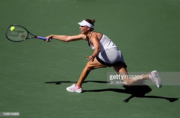 Vera Zvonareva of Russia returns a shot against Kaia Kanepi of Estonia during her women's singles quarterfinal match on day ten of the 2010 U.S. Open...