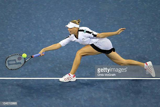Vera Zvonareva of Russia returns a shot against Kim Clijsters of Belguim during her women's singles final on day thirteen of the 2010 US Open at the...