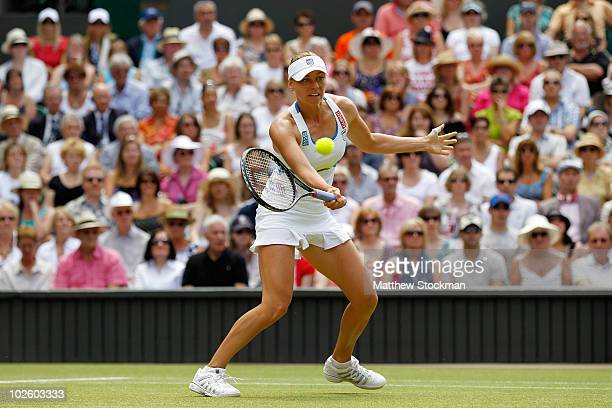 Vera Zvonareva of Russia returns a shot during the Ladies Singles Final Match against Serena Williams of USA on Day Twelve of the Wimbledon Lawn...
