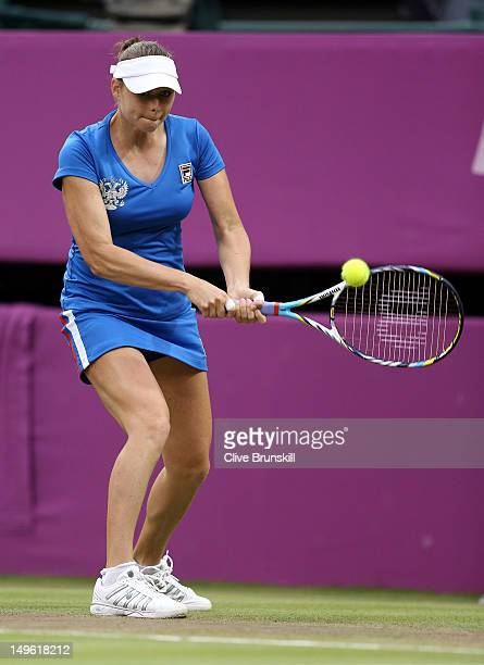Vera Zvonareva of Russia returns a shot to Serena Williams of the United States during the third round of Women's Singles Tennis on Day 5 of the...