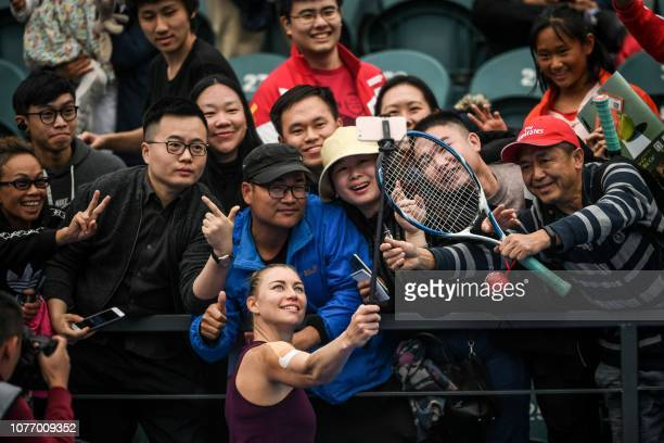 Vera Zvonareva of Russia takes a selfie with fans after winning her women's singles quarterfinal match against compatriot Veronika Kudermetova at the...