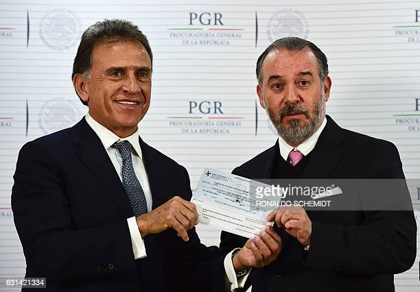 Veracruz´ governor Miguel Yunez poses with Mexican General Attorney Raul Cervantes during a press conference about Veracruz state former governor...