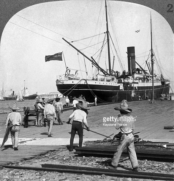 Veracruz Harbour With A LargeSized Boat And Mexican Employees In The Foreground In Mexico Around 19161920 Vera Cruz Is The Country'S Main Port
