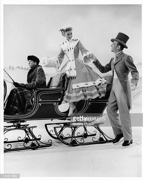 VeraEllen is helped out of a carriage by Fred Astaire in a scene from the film 'The Belle Of New York' 1952