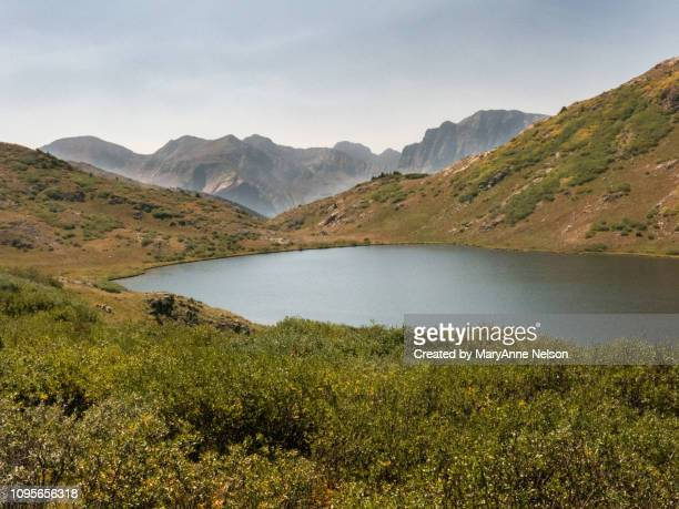 verde lake with mountain background - mary lake stock photos and pictures