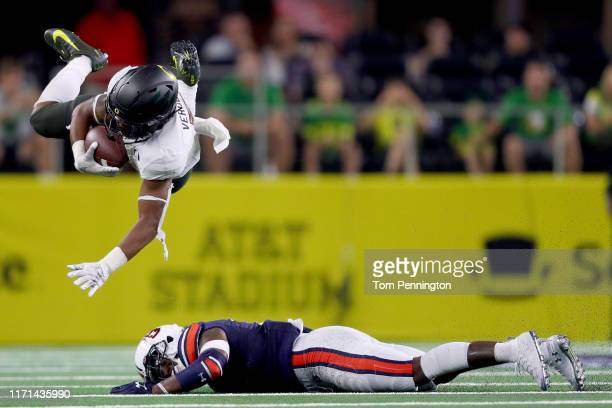 Verdell of the Oregon Ducks carries the ball against Christian Tutt of the Auburn Tigers in the third quarter during the Advocare Classic at ATT...