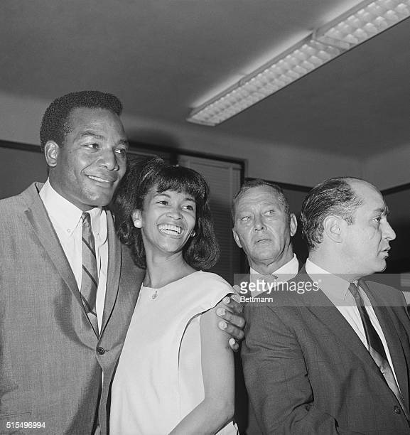 """Verdict of """"not guilty"""" brings smiles to the faces of Cleveland Browns' fullback Jim Brown and his wife, Sue. Brown had been charged with assault and..."""