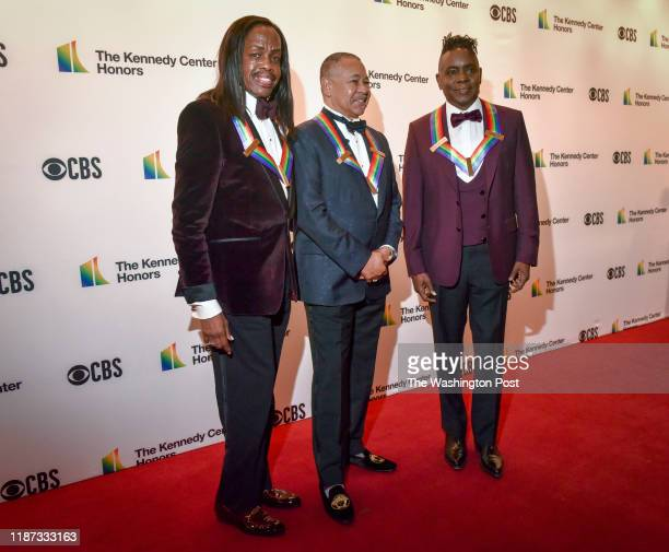 Verdine White Ralph Johnson and Philip Bailey original members of Earth Wind Fire pose on the red carpet as they arrive for the 42nd annual Kennedy...