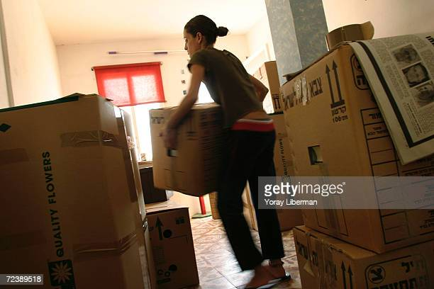 Vered Hazani packs as she and her husband prepare to move August 16 2005 in Kfar Yam Gaza Strip As Israel's disengagement of about 8000 settlers from...