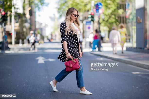 Verena Ahmann wearing a white black satin dots long blazer from Mango beige red shirt and 7/8 denim pants Sincerely Jules Off White coloured shoes...