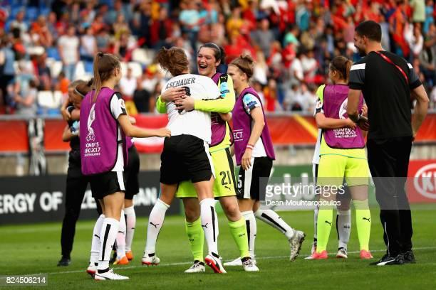 Verena Aschauer of Austria and Jasmin Pfeiler of Autria celebrate victory together after the UEFA Women's Euro 2017 Quarter Final match between...