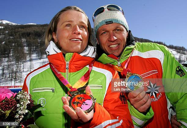 Verena Bentele and guide Franz Lankes of Germany celebrate winning the Women's 5KM Visually Impaired Cross Country with the gold medals in there...