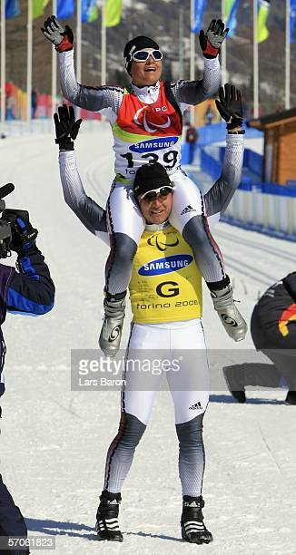 Verena Bentele and guide Franz Lankes of Germany celebrate winning the Women's 5KM Visually Impaired Cross Country during day two of the Turin 2006...