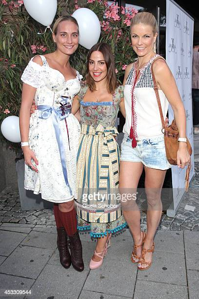 Verena Brock Designer Janina Maria Sendner and Tina Kaiser attend JanIna Trachten Fashion Show at Heart Club on August 07 2014 in Munich Germany