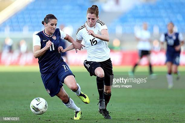 Verena Faibt of Germany challenges Ali Krieger of USA during the Algarve Cup 2013 Final at the Estadio Algarve on March 13 2013 in Faro Portugal