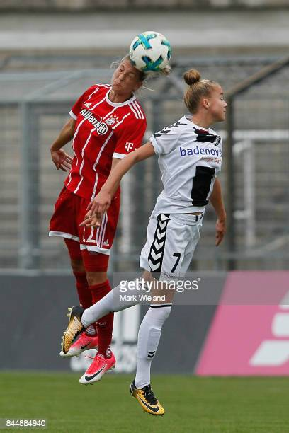Verena Faisst of Bayern Muenchen and Giulia Gwinn of SC Freiburg in action during the women Bundesliga match between Bayern Muenchen and SC Freiburg...