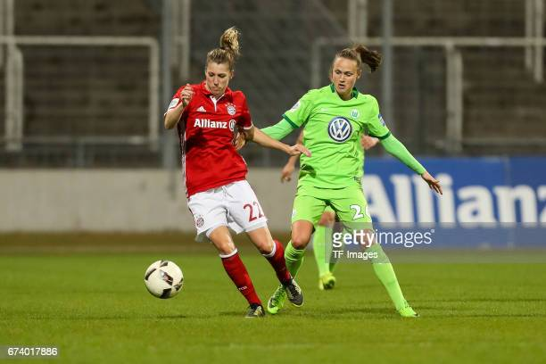 Verena Faisst of Munich and Caroline Graham Hansen of Wolfsburg battle for the ball during the Women's DFB Cup Quarter Final match between FC Bayern...