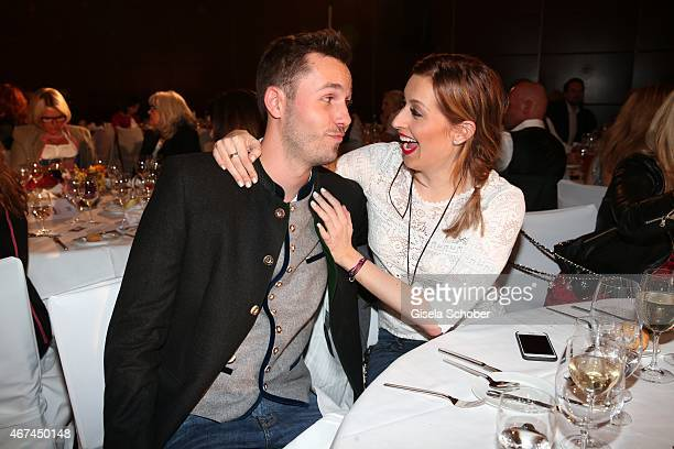 Verena Kerth and Tobias Koppenhoefer pose during the SIXT fashion dinner at Nockherberg on March 24 2015 in Munich Germany