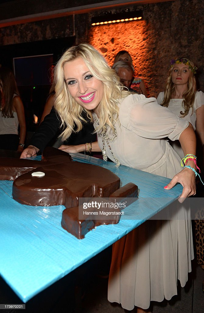 Verena Kerth poses with her birthday cake during the Verena Kerth birthday party at P1 on July 18, 2013 in Munich, Germany. Kerth also celebrated the release of the new Playboy issue with her on the cover.