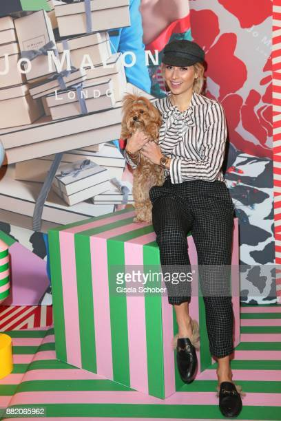 Verena Kerth with her dog Mucki during the Jo Malone London 'Crazy Colourful Christmas' event at Goldberg Studios on November 29 2017 in Munich...