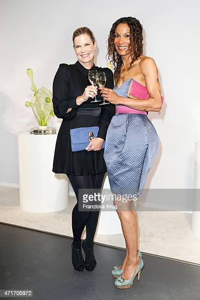 Verena Wriedt and Annabelle Mandeng attend the Hubert le Gall Vernissage At Ruinart PopUp Gallery on April 30 2015 in Berlin Germany