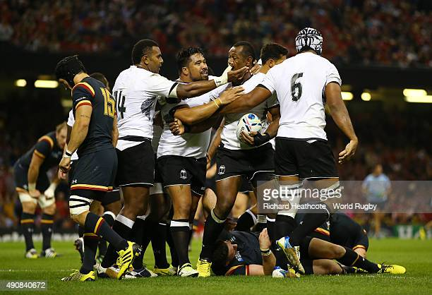Vereniki Goneva of Fiji celebrates with his team-mates after scoring their first try during the 2015 Rugby World Cup Pool A match between Wales and...