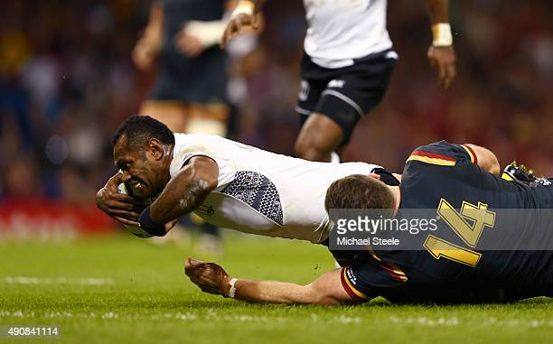 Vereniki Goneva of Fiji scores their first try during the 2015 Rugby World Cup Pool A match between Wales and Fiji at the Millennium Stadium on...