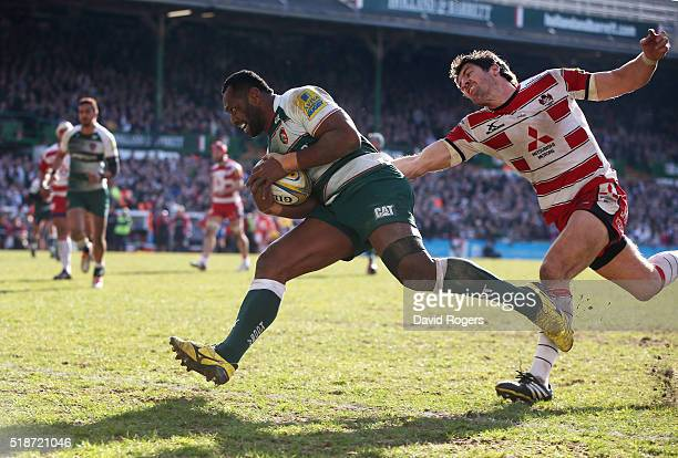 Vereniki Goneva of Leicester breaks clear of James Hook to score a second half try during the Aviva Premiership match between Leicester Tigers and...