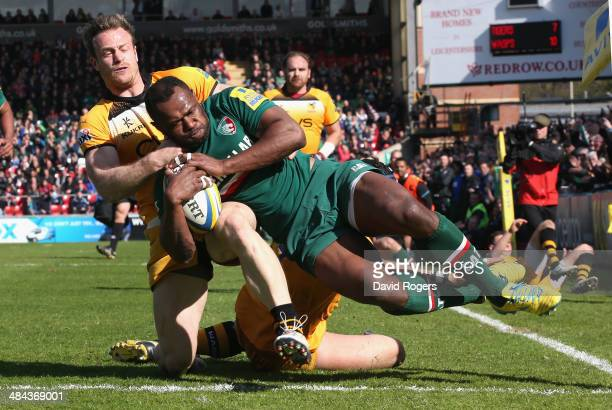 Vereniki Goneva of Leicester dives over for a try despite being held by James Short during the Aviva Premiership match between Leicester Tigers and...
