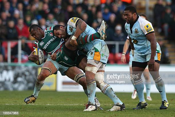 Vereniki Goneva of Leicester is tackled by Samu Manoa during the Aviva Premiership match between Leicester Tigers and Northampton Saints at Welford...