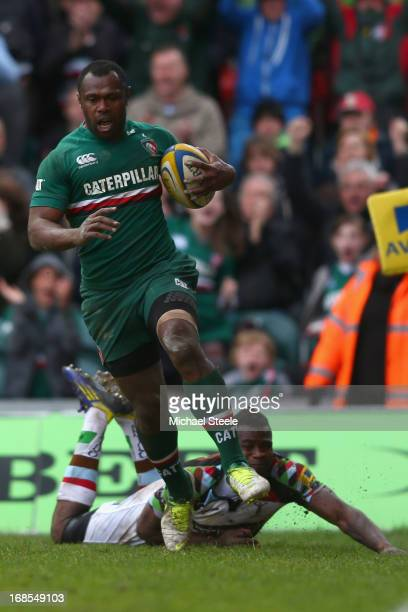 Vereniki Goneva of Leicester Tigers evades the challenge from Ugo Monye of Harlequins to score the opening try during the Aviva Premiership match...