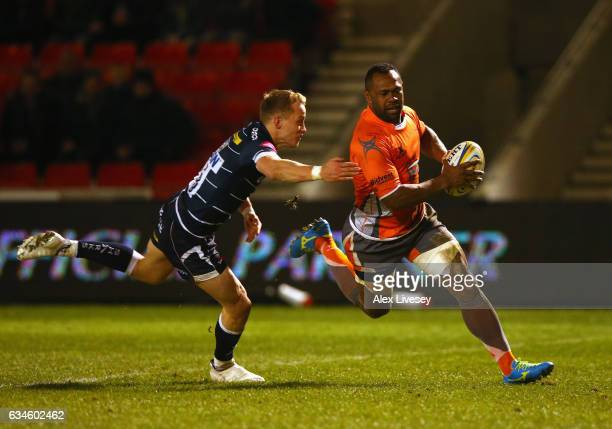 Vereniki Goneva of Newcastle Falcons beats a challenge from Mike Haley of Sale Sharks to score his third try during the Aviva Premiership match...